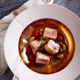 SEARED TUNA WITH TOMATO, SAFFRON, CITRUS AND BUTTER BEANS