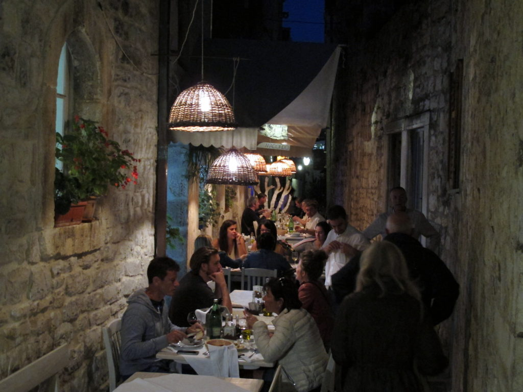 Alfresco dining between ancient walls. - exploring croatia