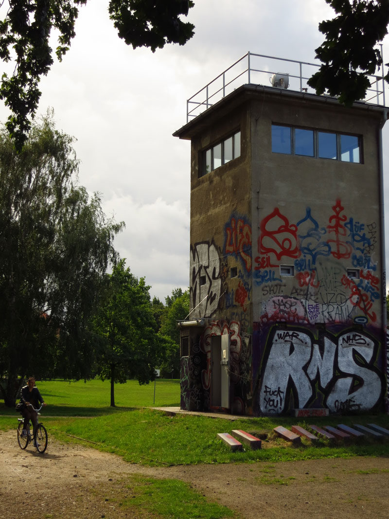 A former guard tower overlooking what was no man's land beside the Berlin wall serves as a reminder of history.
