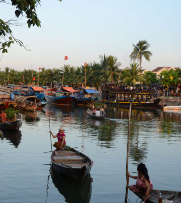 IN THE EVENINGS, HOI AN COMES TO LIFE WITH FOOD STALLS AND BOATS ON THE RIVER.