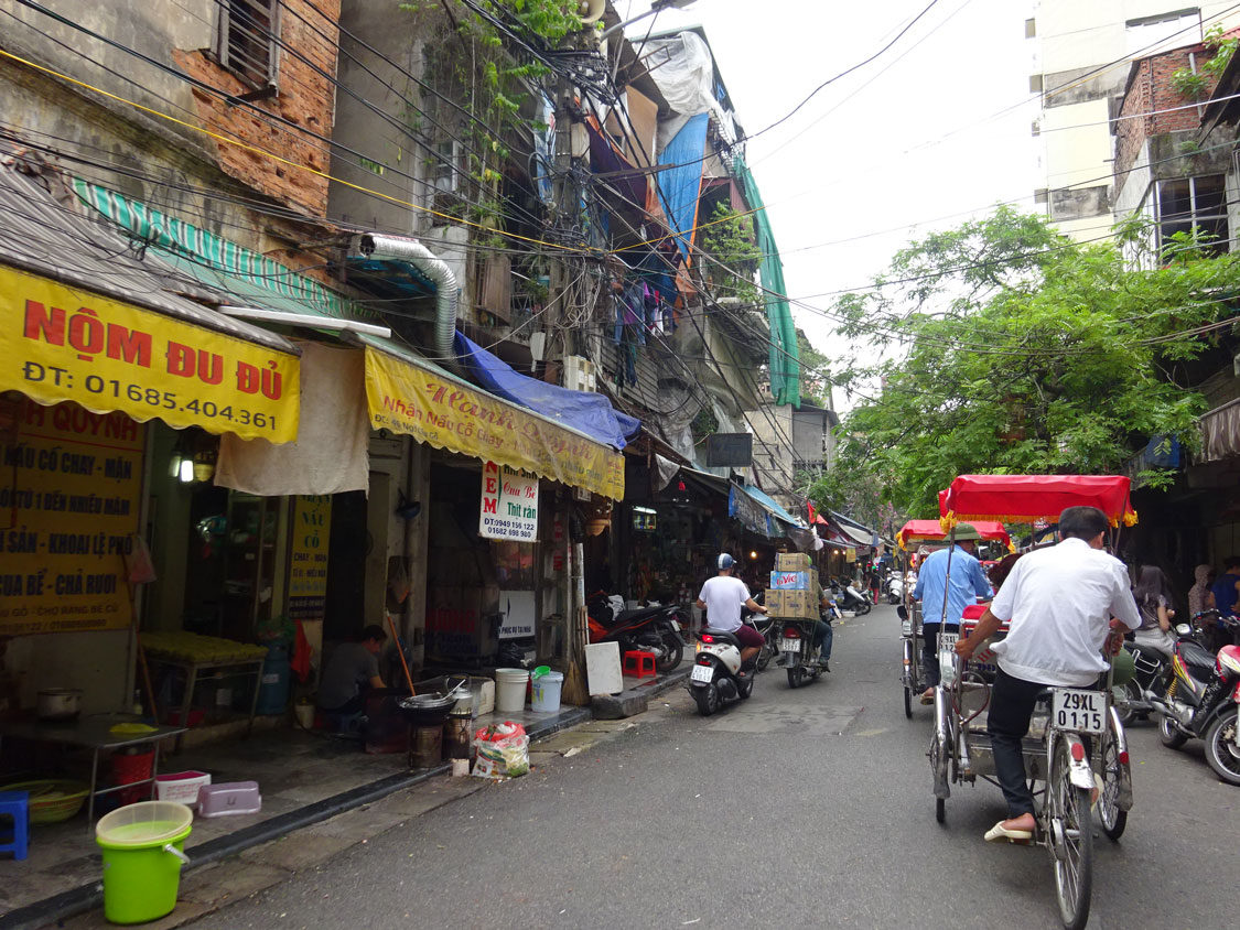 THE OLD QUARTER IN HANOI WITH ITS NARROW STREETS DRAPED WITH ELECTRICITY LINES.