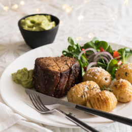 PEPPER-CRUSTED FILLETS WITH HASSELBACK POTATOES AND AVOCADO SAUCE