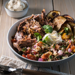 Slow-cooked, pull-apart fragrant lamb with quinoa, herb and tomato salad